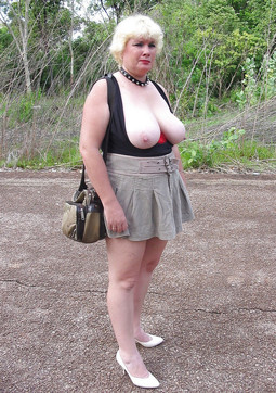 Chubby mature posing naked in the woods