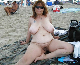 Naked middle-aged woman on the nudists..