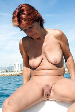 Redhead smoking granny totally naked..