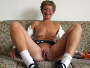 Nude grandma posing